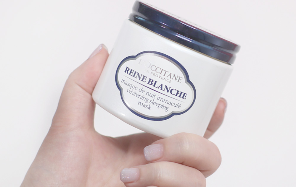 L'OCCITANE Reine Blanche Whitening Sleeping Mask - Jar in hand