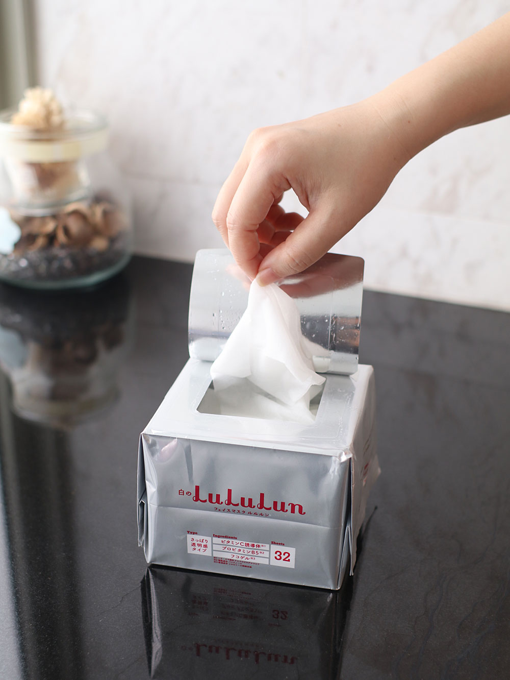 image of Lululun Face Mask - taking a piece out from the box - whitening